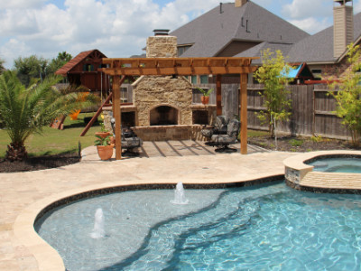 Pool with fireplace and patio.